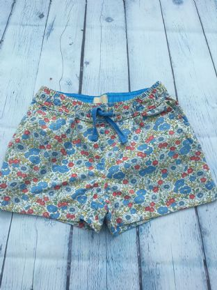 Mini Boden Liberty print blue shorts with heart pockets age 6-7